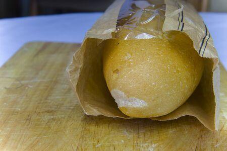 Fresh Baguette in a paper bag closeup copy space.High resolution image gallery. Banco de Imagens