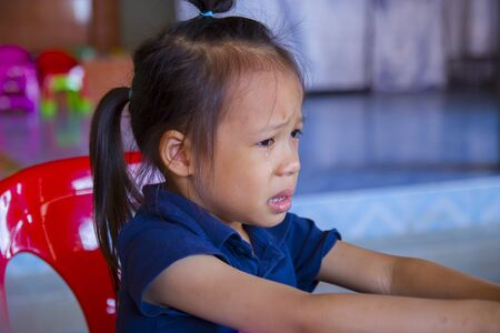 The Sadness of the Lovely Asian kid crying, Asian little girl crying and sad