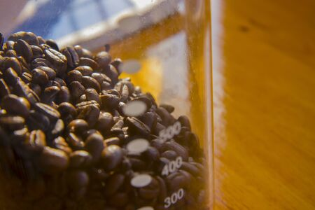 Fresh coffee beans into the glass, Food concept Front view copy space.