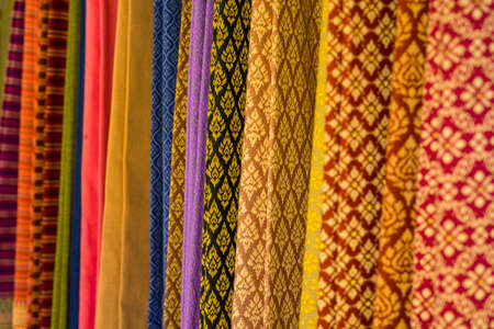 Raw of colorful Thai silk handcraft old vintage torn from natural materials texture background.