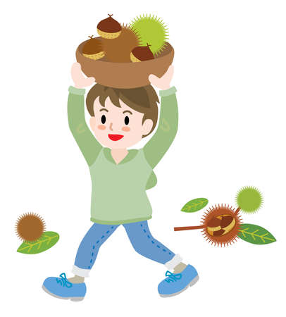 A boy gathering chestnuts in the autumn