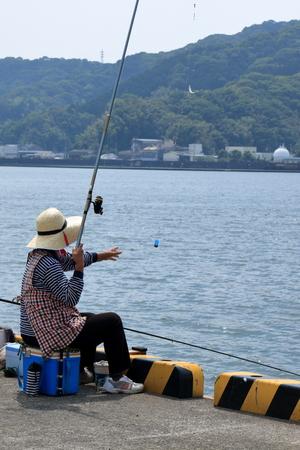 I enjoyed fishing at the harbor. Stock Photo