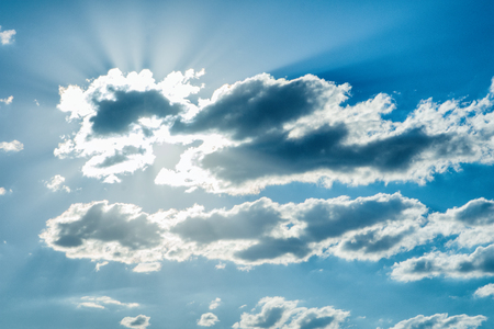 Beautiful celestial landscape. Clouds and sun at sunset. Clouds and sun at dawn. The radiance of the sunlight.