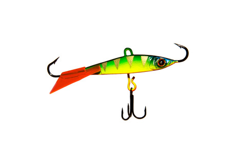 Winter bait balancer for predatory fish. Bright yellow with green balancer. With red fin and pattern. On white background. Isolated.