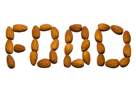 Close-up of almonds. A word made up of nuts. Screen saver. On white background. Isolated.
