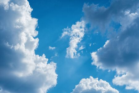 Blue sky with storm clouds. Blue sky with clouds closeup. The natural background. Texture.