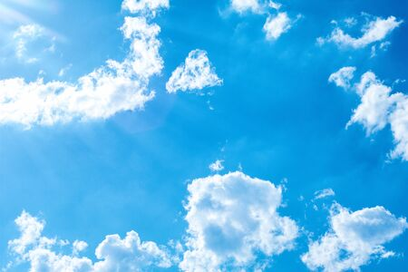 Beautiful blue sky and clouds. Beams of light. The natural background. Texture. 写真素材