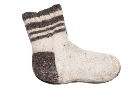 Wool socks. Warm knitted socks made of natural sheep wool. Isolated on white background.