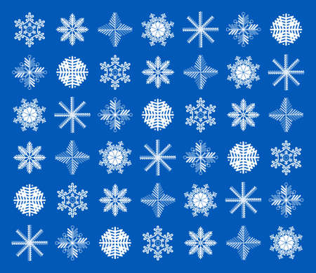 White snowflakes on a dark blue background. Desktop Wallpaper. The design of the snowflakes.
