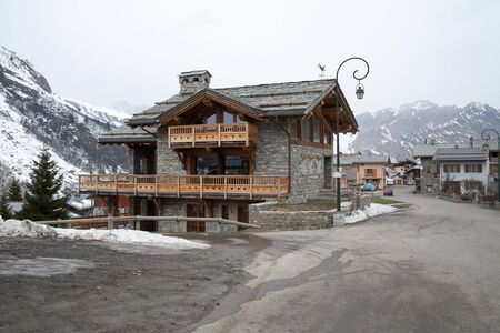 house in a mountain village in the Alps in winter