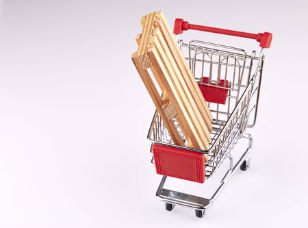 Pallet in red shopping cart isolated on white background