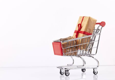 Red shopping cart with presents boxes