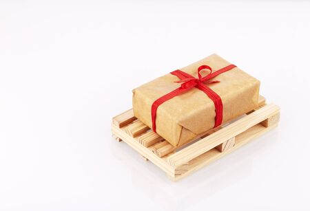delivery presents in boxes with red ribbon on pallet