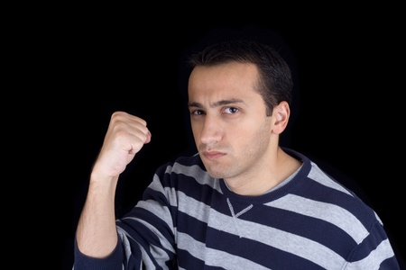 Angry young man isolated on black background Stock Photo - 8289787