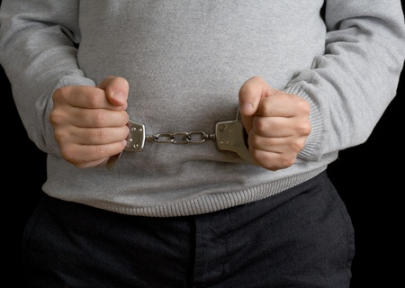 Man in handcuffs on black background Stock Photo - 8418596