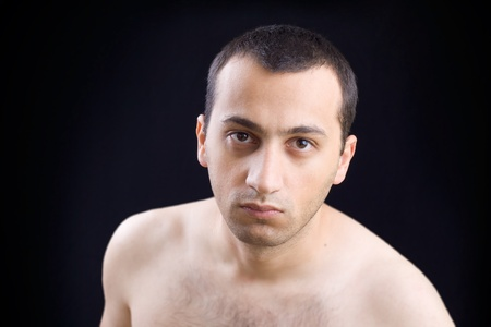 Portrait of a young man isolated on black background