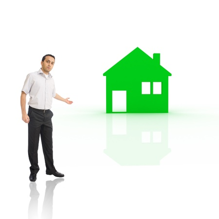 Young man presenting green house Stock Photo