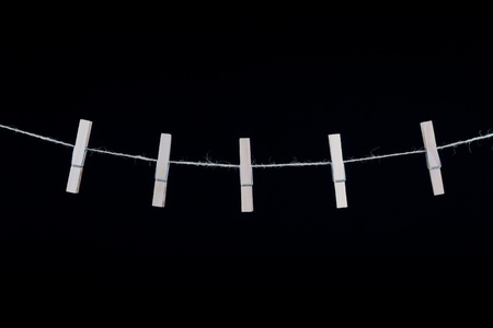 Clothespins isolated on black background