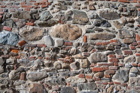 Wall of bricks and stones as a texture Stock Photo
