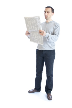 the reader: Young man reading newspaper