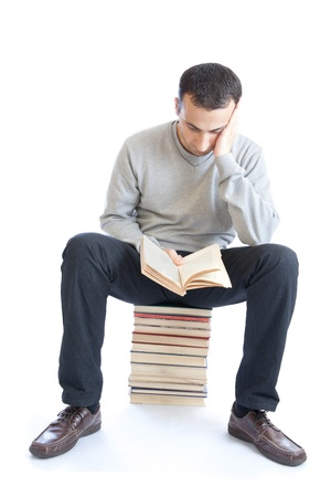 young man reading a book on white background Stock Photo