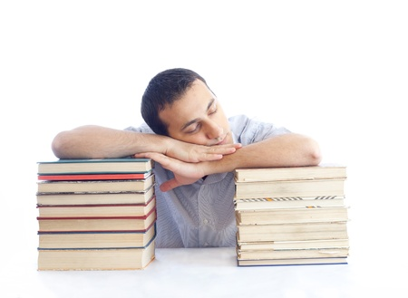 a young man with a pile of books sleeping Stock Photo