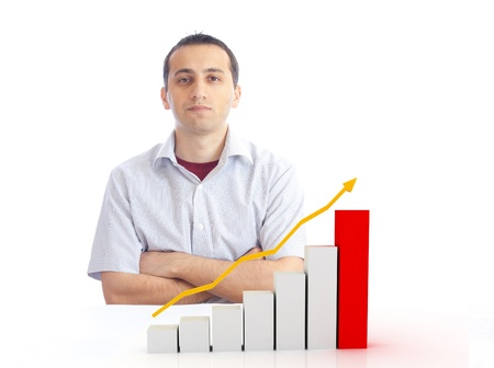 a young man with a rising chart Stock Photo