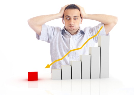 a young man with a falling chart Stock Photo - 9181364