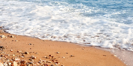 Photo of sand and wave Stock Photo