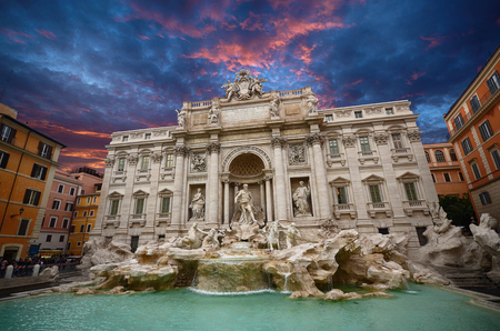Beautiful sunset over the one of the famous fountain in the world, Trevi fountain in Rome, Italy