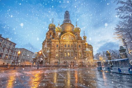 View of famous church of Savior on Spilled Blood (Resurrection of Christ cathedral) and Griboedov Canal at frosty snow winter morning day, Saint Petersburg, Russia. Christmas mood