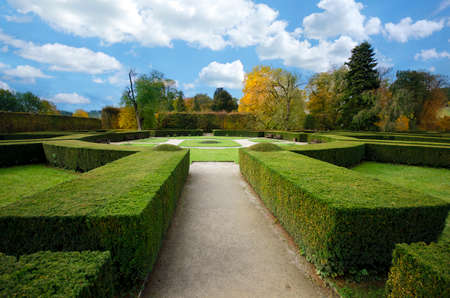 The Castle Gardens in Cesky Krumlov, Czech Republic with blue sky. Hedge labyrinth. A park and maze from Perfect bushes and trees