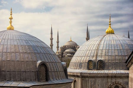View of the famous Sultanahmet Imperial Mosque (Sultan Ahmet Cami) , also known as the Blue Mosque domes and minarets in Istanbul Turkey. Built in the 17th century by the architect Mehmet