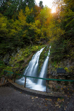 Cascada Urlatoarea Busteni (Urlatoarea waterfall) Howling in Bucegi mountains, Romania near to Sinaia. Nature wonder in the Carpathian Mountains park.