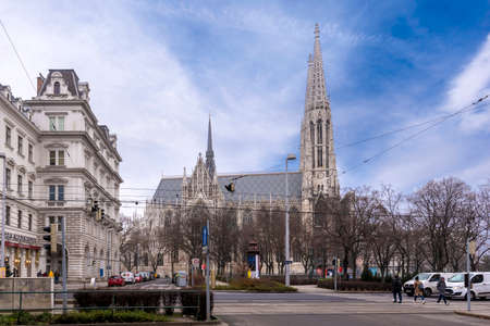Vienna, Austria - 28 January, 2020: Gothic Votive Church (Votivkirche) on Ringstrasse - second-tallest church in the city. Church consecrated in 1879 on occasion of Imperial Couple's Silver Wedding