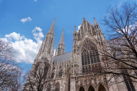 Famous Neo-Gothic Votive Church (Votivkirche) on Ringstrasse - second-tallest church in Vienna, Austria. Church consecrated in 1879 on occasion of Imperial Couple's Silver Wedding.