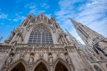 Famous Neo-Gothic Votive Church (Votivkirche) on Ringstrasse - second-tallest church in Vienna, Austria. Church consecrated in 1879 on occasion of Imperial Couple's Silver Wedding. Stock Photo