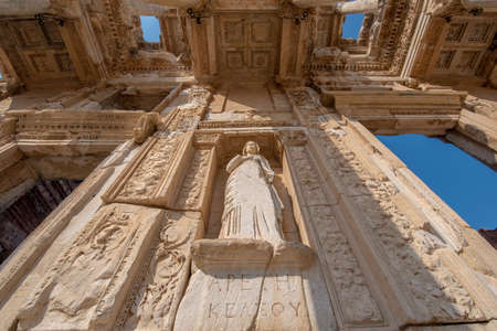 Library of Celsus and sculpture in the ancient city of Ephesus, Selcuk Izmir, Turkey. The UNESCO World Heritage site was is an ancient Roman building on the coast of Ionia in honour of Tiberius. Efes Editorial