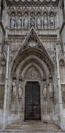 Door or gate of Neo-Gothic Votive Church (Votivkirche) on Ringstrasse - second-tallest church in Vienna, Austria. Church consecrated in 1879 on occasion of Imperial Couple's Silver Wedding.