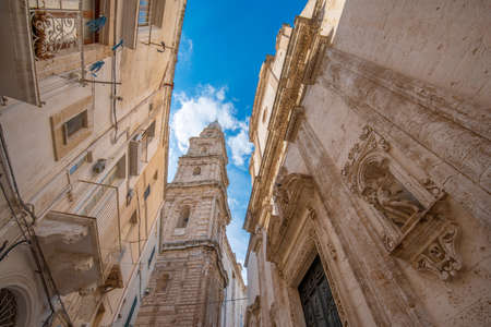 Bell tower of Cathedral Maria Santissima della Madia (Basilica Cattedrale Maria Santissima della Madia) and Fraternal Organization of our Lady of Suffrage in old town Monopoli, Puglia, Italy. Apulia