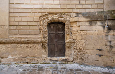 Lecce, Puglia, Italy - March 08, 2019: Medieval historical center in the old town. View and detail of an ancient gate or door. A region of Apulia Editorial