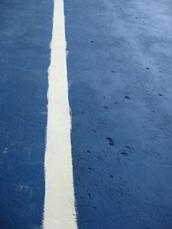 mitzrah: Concrete wall with a badly painted white line for tennis practice