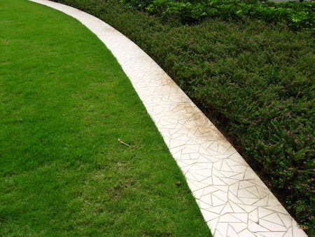 mitzrah: A Clean Garden with golf turf grass and small bushes