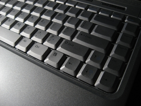 mitzrah: Modern computer Laptop Keyboard - Dramatic Lighting photo