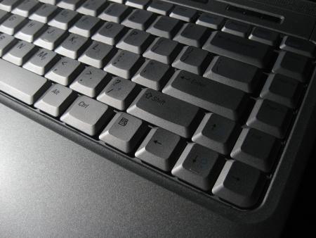 geeky: mitzrah: Modern computer Laptop Keyboard - Dramatic Lighting Stock Photo