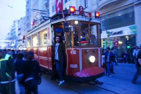 May 2011 - Tourists enjoying the tram ride in İstiklal Caddesi, Taksim Square, Istanbul, Turkey