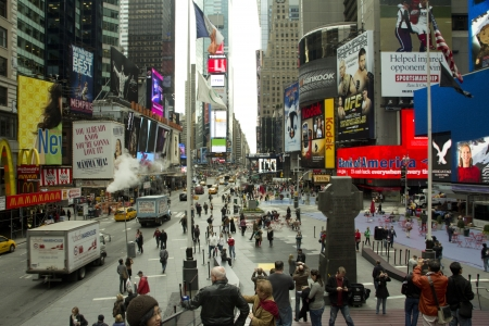 Times Square, New York City, United States of America - View from Times Square platform with tourists, neon and display advertising