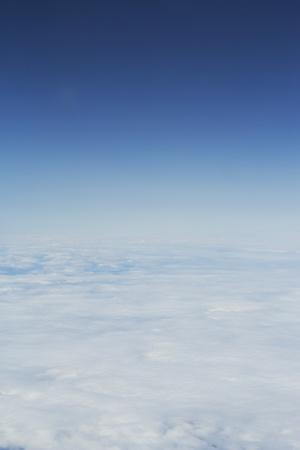 Cloudscape view outside an aircraft midflight