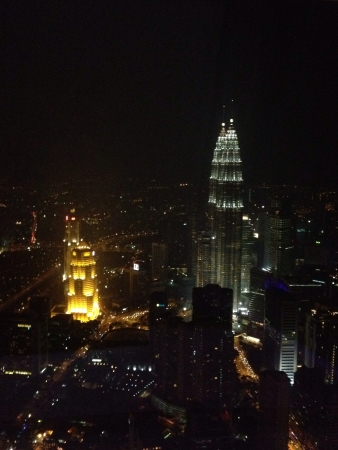 kl: View of Petronas Twin Towers from The revolving restaurant at KL Tower