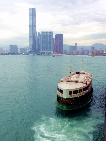 Ferry coming in to dock at Victoria harbor Hong Kong  Stock Photo